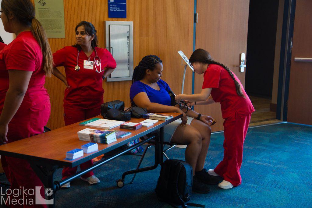 Audience member getting health screening