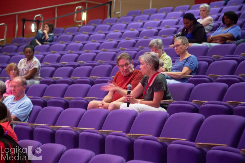 Audience members asking questions at film screening event