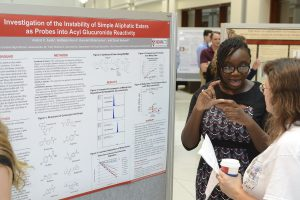 Aishat presenting her poster at 2015 Project SEED poster session