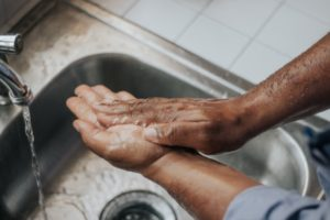 hands washing with soap in sink