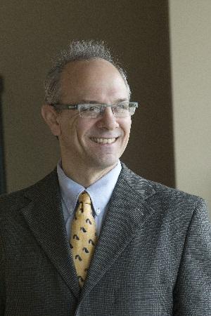 Headshot of Andrew Brightman