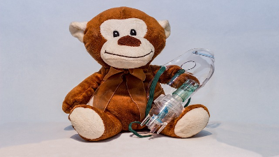 photo of stuffed bear with asthma medication