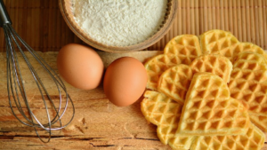 photo of eggs, waffles and bowl of flour
