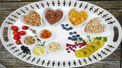 photo of nuts, fruits and grains on a platter