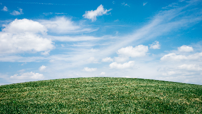 photo of grassy hill and blue cloudy sky