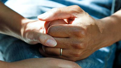 photo of two hands holding hands