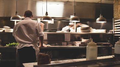 photo of staff working in a restaurant kitchen