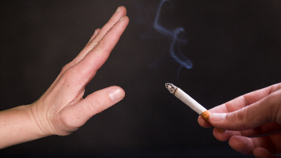 photo of hand refusing a cigarette that is being offered