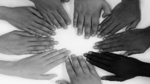 photo of hands of many races in a circle