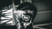 photo of a head covered with a hood and smoke with NO! on a mask