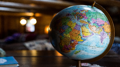 photo of a globe on a desk