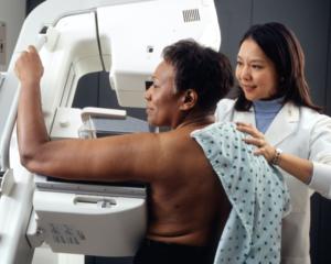 black woman undergoes mammogram