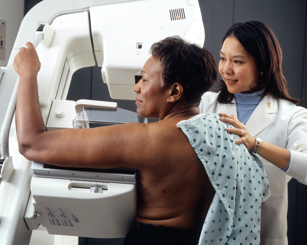 black woman undergoes mammogram
